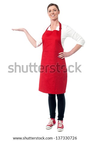 Smiling female chef welcoming you to her newly opened restaurant. - stock photo