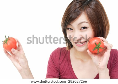 smiling female face with holding two tomatoes - stock photo