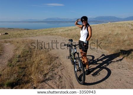 Smiling female mountain biker - stock photo