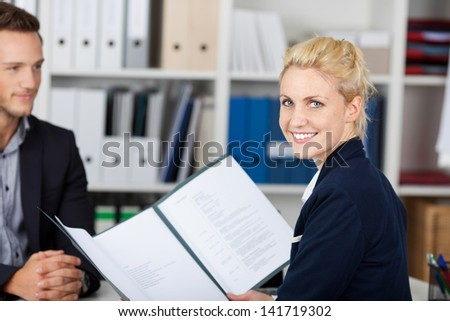 Smiling female recruiter and male candidate during a job interview - stock photo