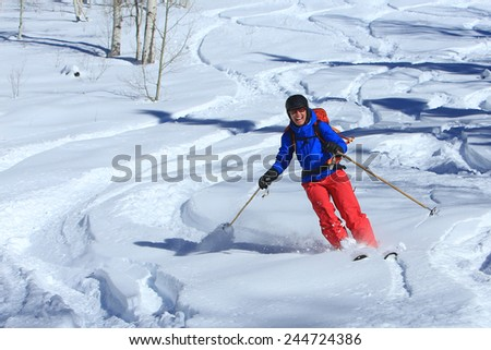 Smiling female skier in fresh powder, Utah, USA. - stock photo