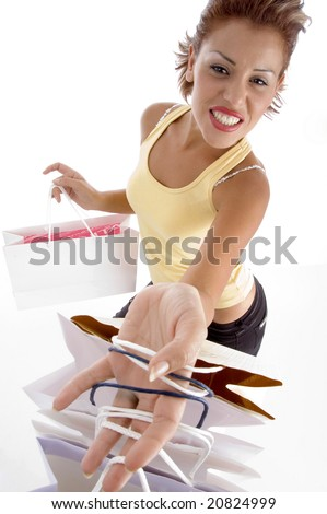 smiling female with holding carry bags on an isolated white background - stock photo