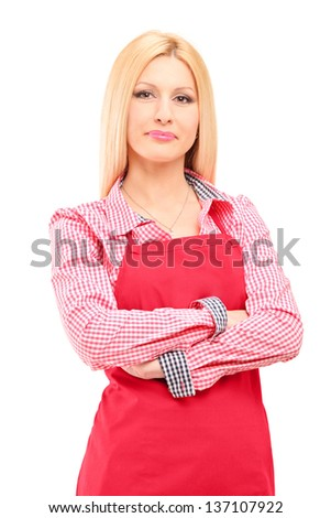 Smiling female worker wearing an apron and looking at camera isolated on white background - stock photo