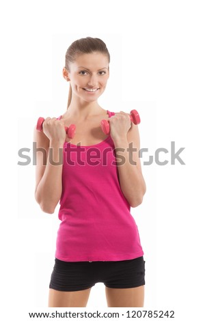 Smiling fit girl with dumbbells in her hands looking at camera, on white background