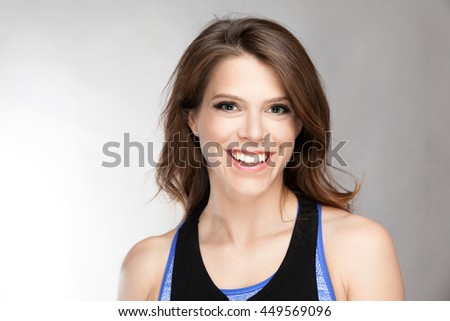 Smiling fit young and attractive woman in studio