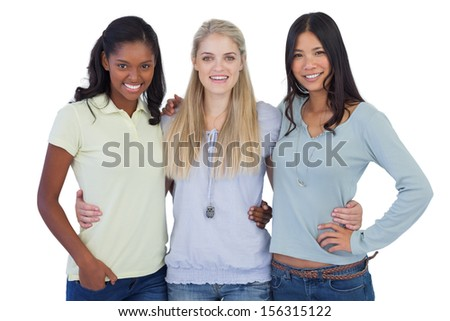 Smiling friends embracing and looking at camera on white background