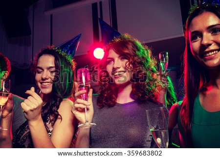 smiling friends with glasses of champagne in club - stock photo