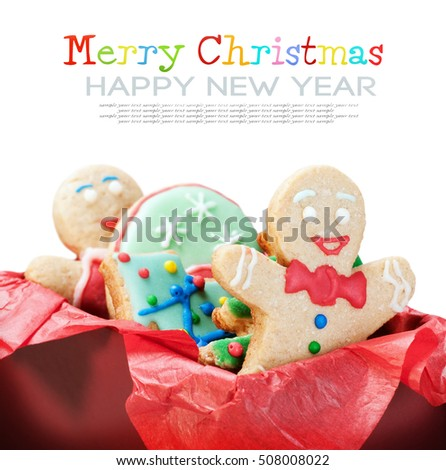 smiling gingerbread man cookies and the rest in a gift box on a white background. delete text