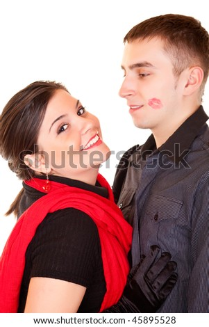 smiling girl and her boyfriend with lipstick on his face