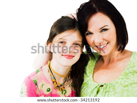 Smiling girl and woman posing isolated over white