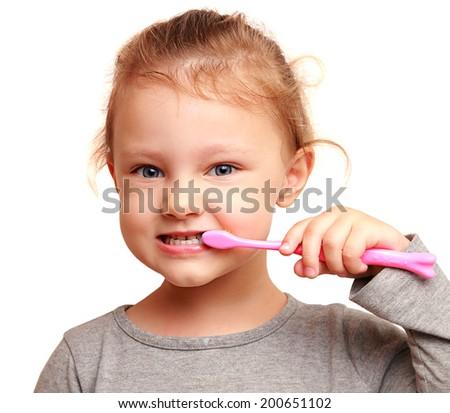Smiling girl child brushing teeth. Isolated closeup portrait - stock photo