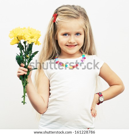 Smiling Girl hold yellow flowers. Fashion child portrait.