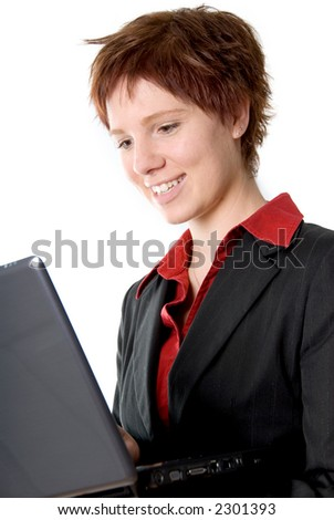 smiling girl holding a grey laptop in her hand