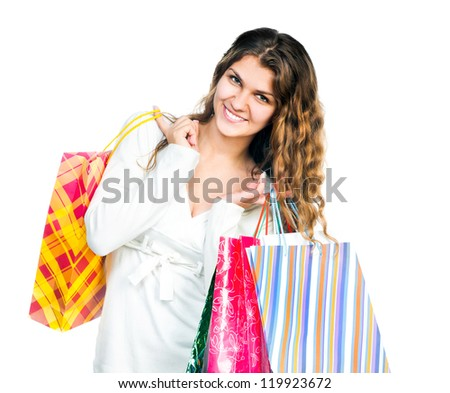 Smiling girl holding colorful shopping bags