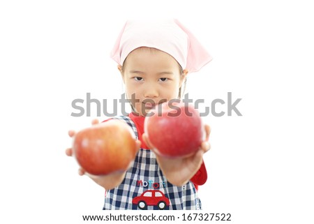 Smiling girl holding  fruits - stock photo