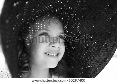 smiling girl in a wide hat