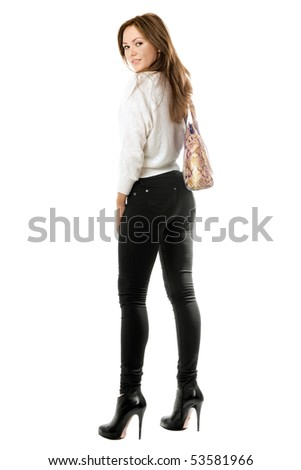 Smiling girl in black tight jeans. Isolated on white