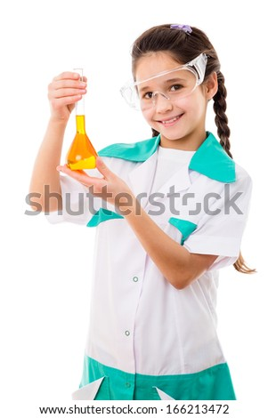 Smiling girl in protective wear holding a chemical flask with yellow liquid, isolated on white - stock photo