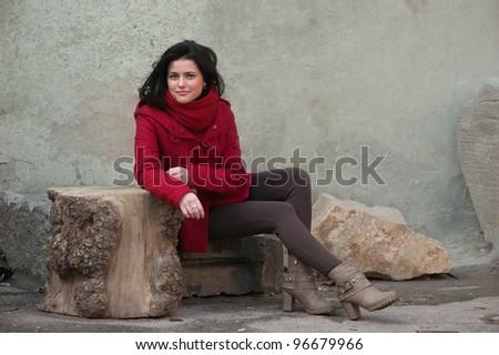 Smiling girl in red coat - stock photo