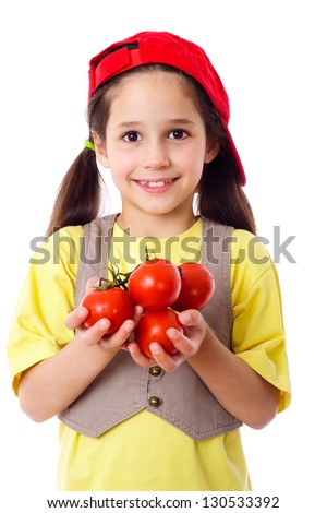 Smiling girl in red hat with tomatoes in hands, isolated on white - stock photo