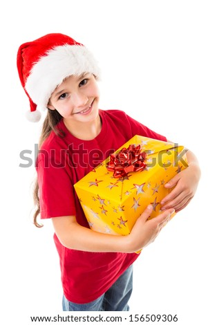 Smiling girl in Santa hat with yellow gift box, isolated on white