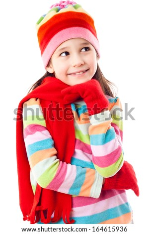 Smiling girl in winter clothes looking sideways, isolated on white - stock photo