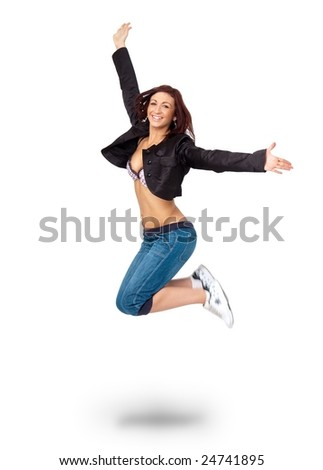 Smiling girl jumping against isolated white background