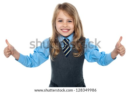 Smiling girl kid showing double thumbs to camera. - stock photo