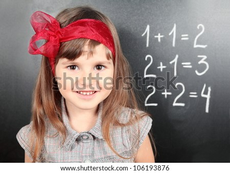 Smiling Girl Near Blackboard Learning Mathematics Portrait - stock photo
