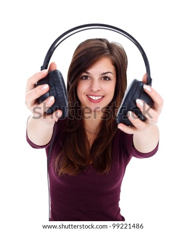 Smiling girl offering us headphones