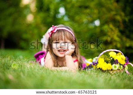 Smiling girl on the meadow - stock photo