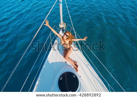 Smiling girl on white yacht. Lady sitting on yacht deck. Enjoying the summer. Health and leisure. - stock photo