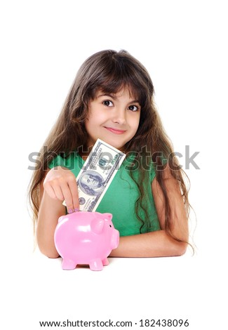 smiling girl putting money in a piggy bank