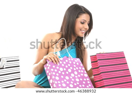 Smiling girl seeing all her shopping nags - stock photo