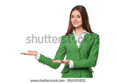 Smiling girl showing open hand palm with copy space for product or text. Business woman in green suit, isolated over white background - stock photo