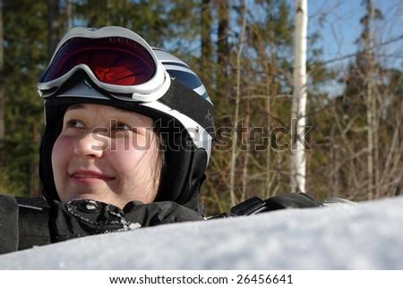 Smiling girl snowboarder - stock photo