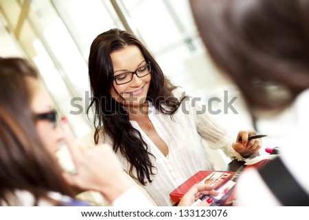 smiling girl thinking on examinination - stock photo