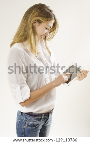 smiling girl using tablet - stock photo
