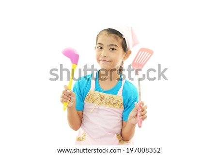 Smiling Girl Wearing Apron - stock photo