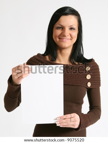 Smiling girl with blank banner. - stock photo