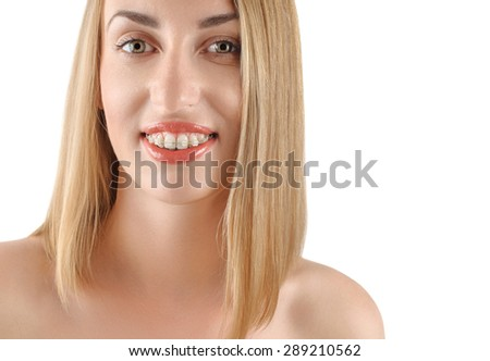 Smiling girl with braces on a white background - stock photo