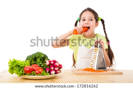 Smiling girl with grater eating the carrots, isolated on white - stock photo