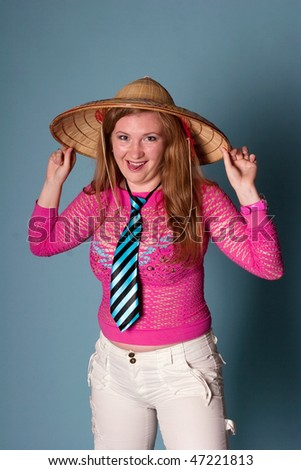 smiling girl with hat on blue background - stock photo