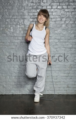 Smiling girl with jumping rope - stock photo