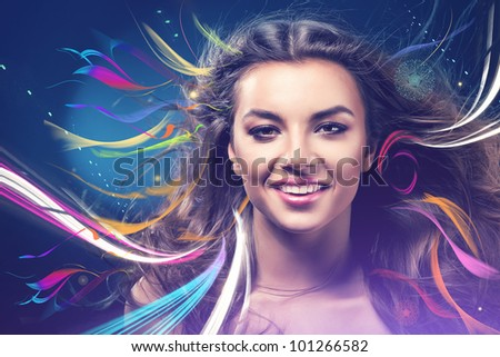 smiling girl with rainbow on wind - stock photo