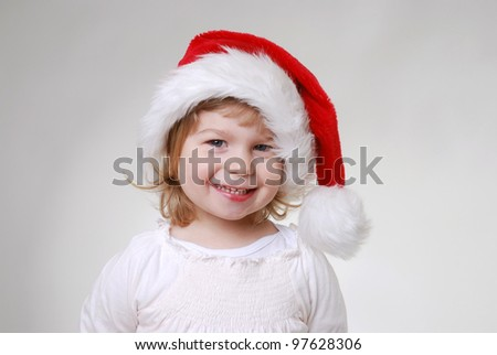 smiling girl with santa hat