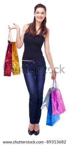 Smiling girl with shopping bags. Isolated on a white background.