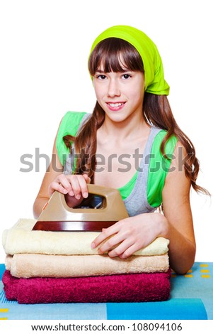 Smiling girl with towels and iron