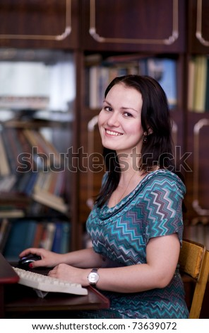 Smiling girl working on computer - stock photo