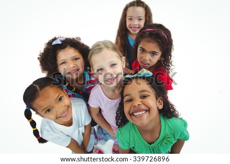 Smiling girls all looking upwards against a white background
